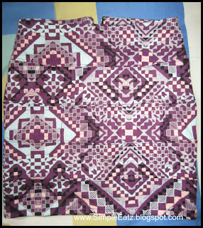 Mini skirt. Pattern: Mosaic design with purple, dark purple, mint green, pink, black color.