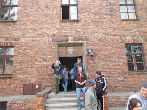 """Tourists visiting one of the museum buildings of """"Auschwitz-I"""" concentration camp."""