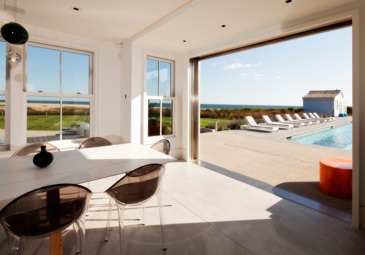 Open terrace doors in Contemporary style home on the beach