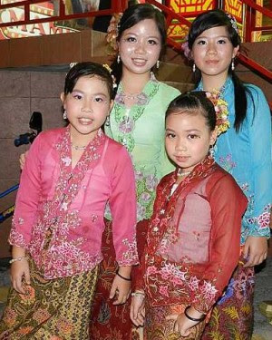 Looking pretty: Four young Nyonyas clad in vibrant kebaya and sarung at the Baba Nyonya Night at Jonker Street, recently.