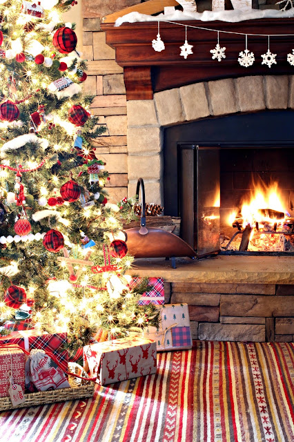Rustic Christmas tree with plaid ball ornaments in front of stone fireplace - www.goldenboysandme.com