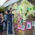 Kinderen schilderen duurzame kunst op elektriciteitshuisjes