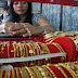 Kebijakan China memberikan dampak pada penurunan harga emas