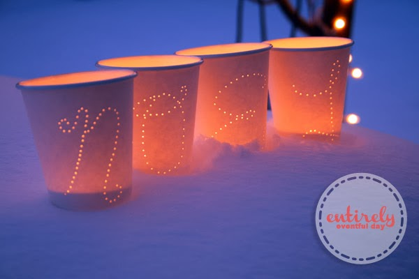 DIY Paper Cup Luminaries. So pretty, festive, and easy. You could make them say anything! www.entirelyeventfulday.com #luminaries #crafts
