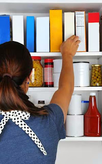 Woman with a Professionally Organized Pantry