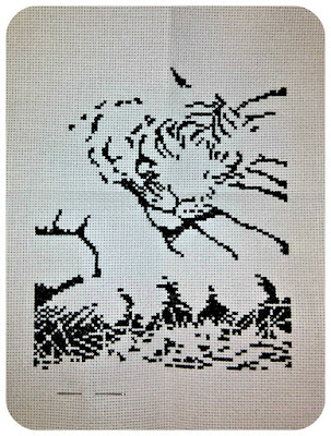 The black layer of a cross-stitch showing a tiger cub sleeping on his mother's tail.