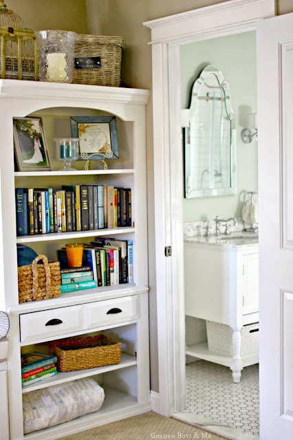 built in bookshelf in master bedroom and white master bathroom via www.goldenboysandme.com