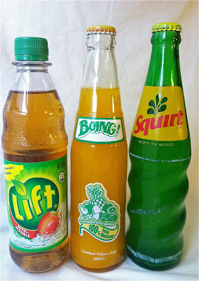 Three soda bottles with labels that read Lift Boing! Squirt