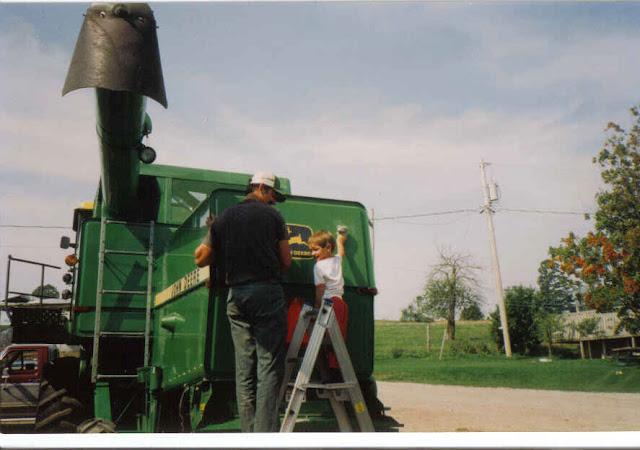 Waxing John Deere 9400 combine