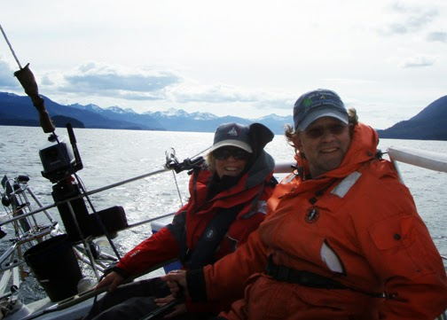 Karen Schmitt with her husband Mike Rentel aboard their sailboat the High Noon.