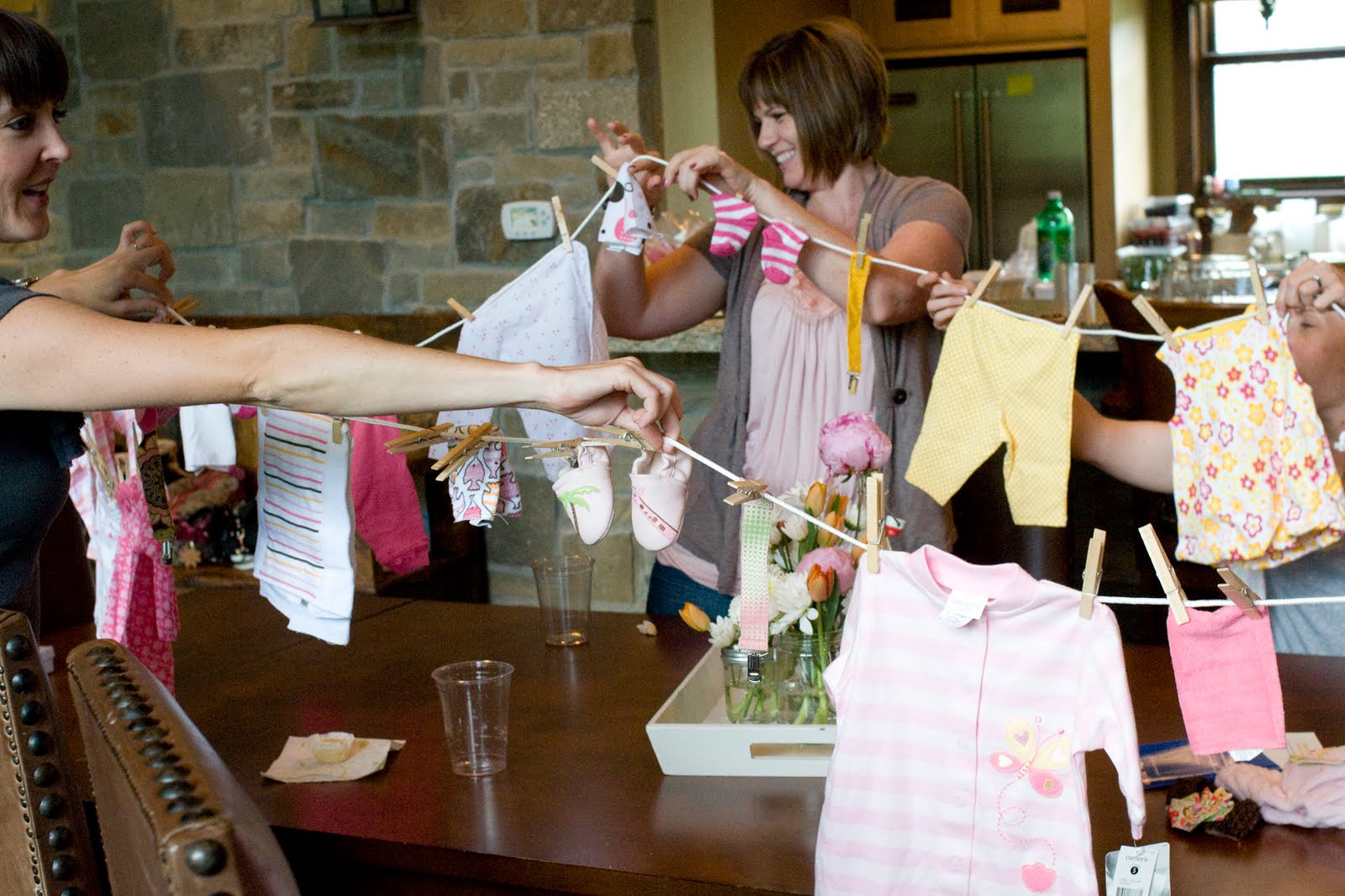 Love laughter baby shower gift ideas for Baby shower clothesline decoration