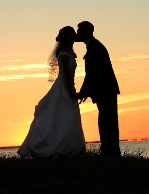 Sunset kissing couple image