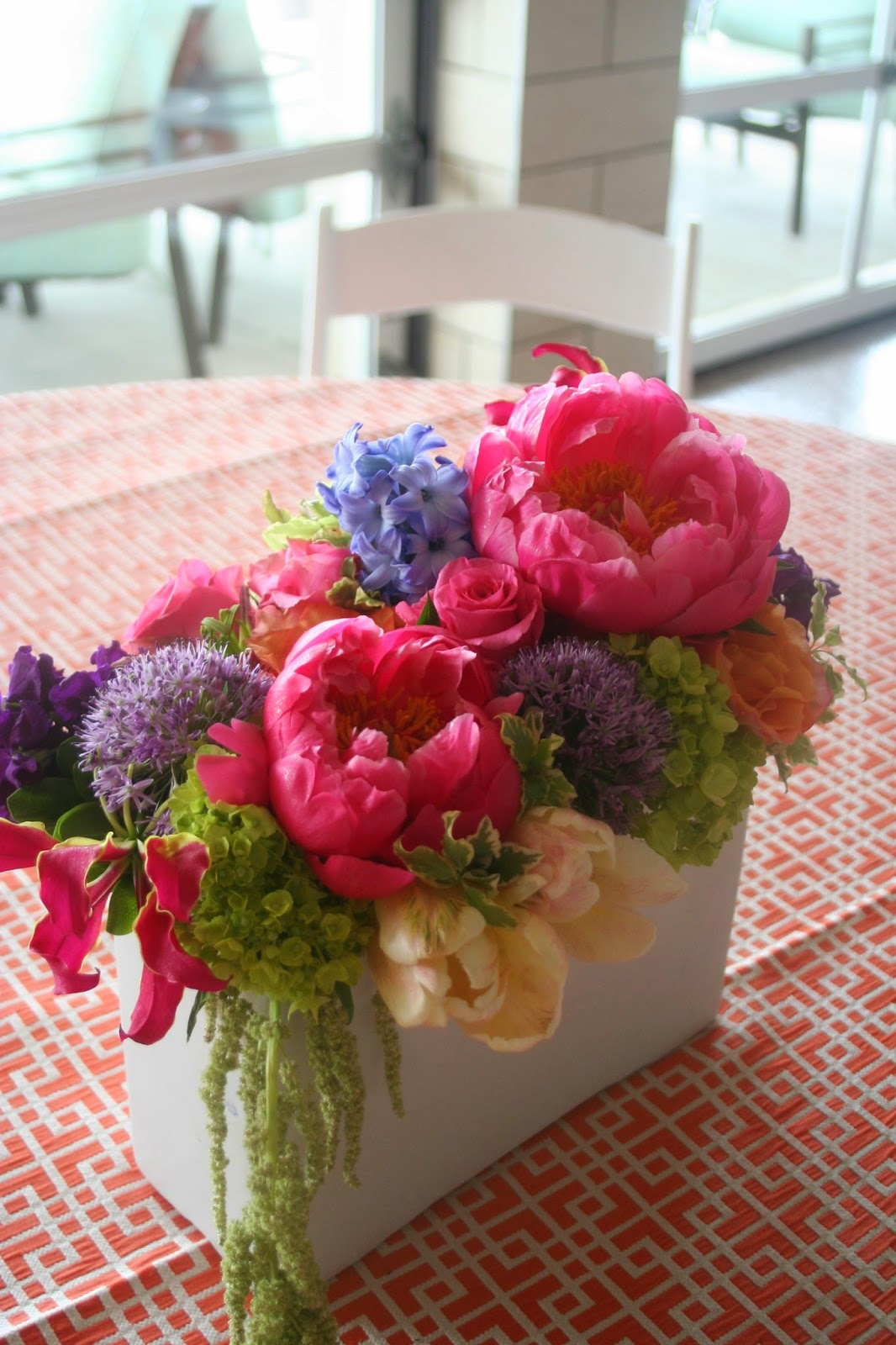 Coral Charm peony, stock, roses, allium, gloriosa, trick, engagement, centerpiece, Isha Foss Events, Cavalier Golf, Papaya linen.