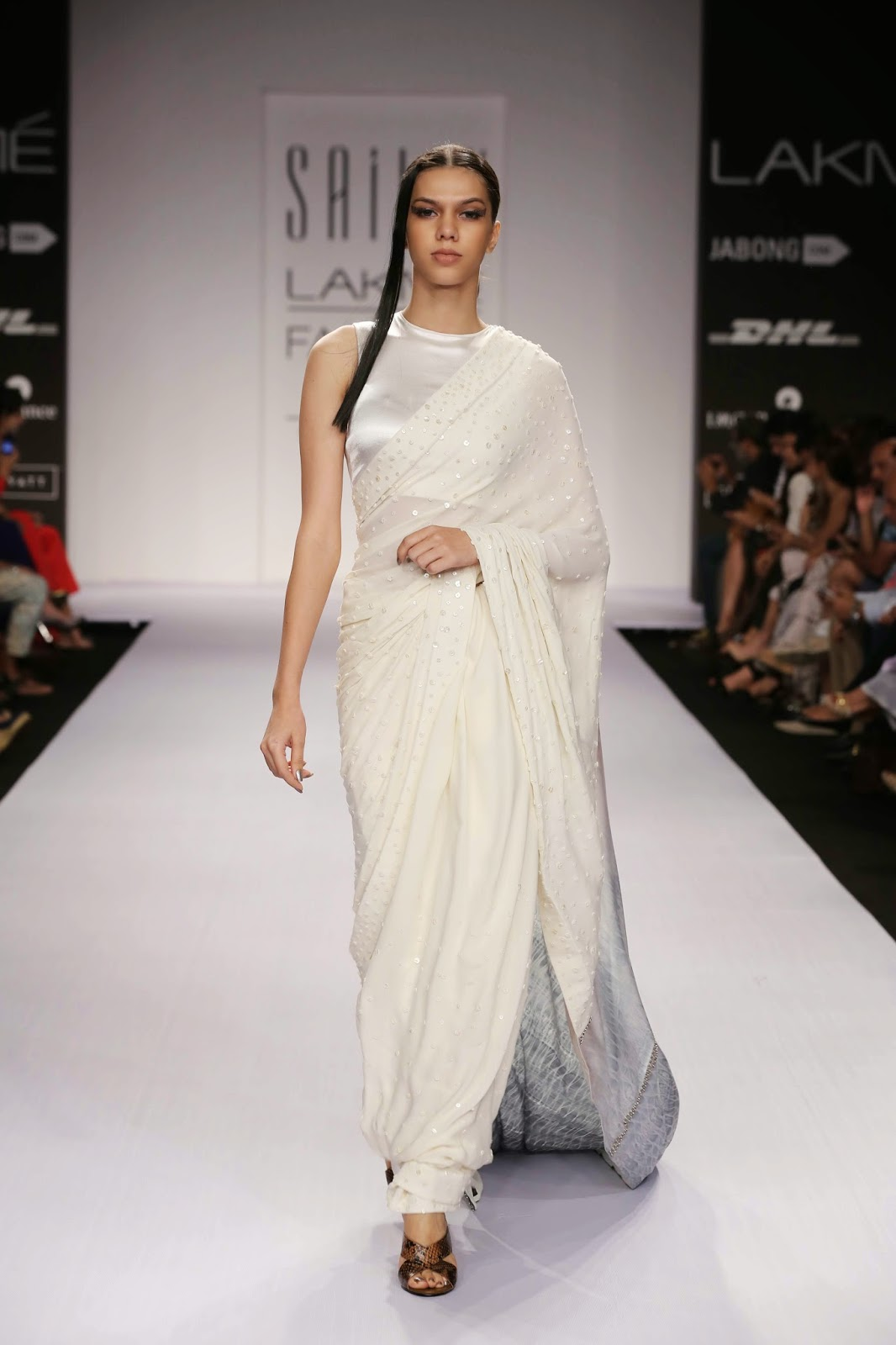 The two saris were an offering to the ethnic wearer with mother-of- pearl embellishments in crepe georgette with shibori pallav worn with stretch satin blouse.