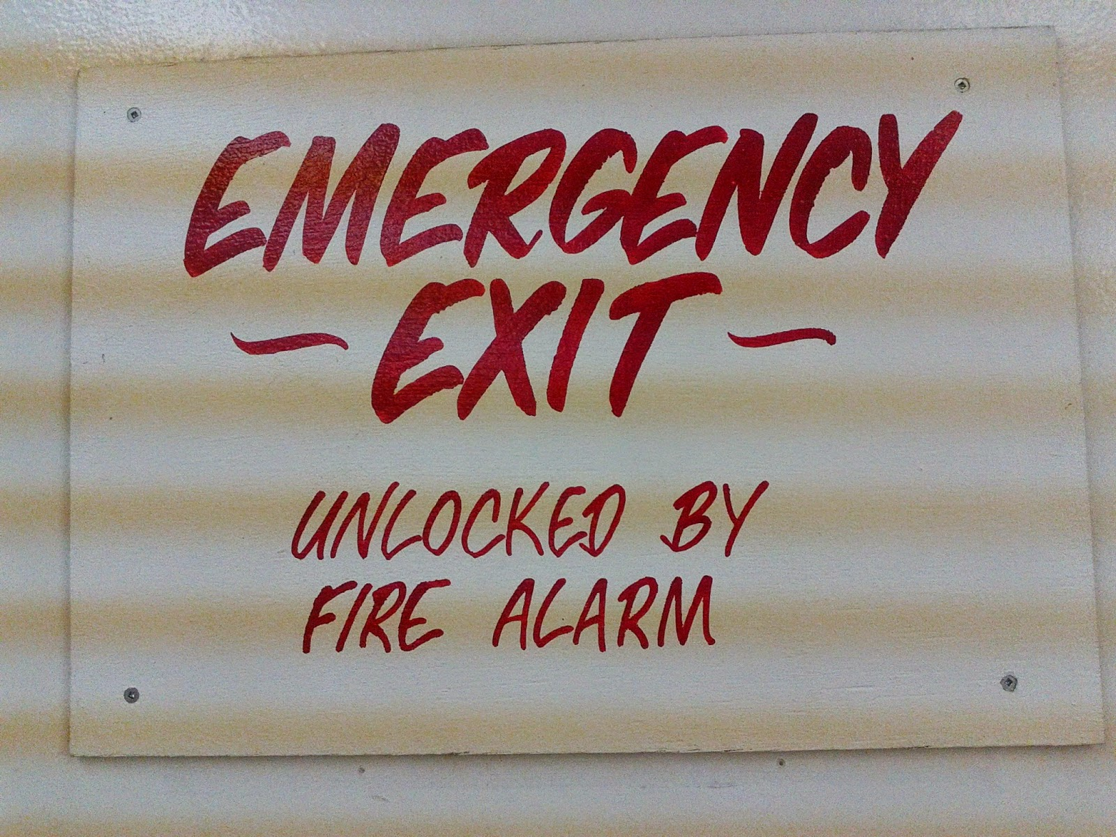 Stock photo: Emergency Exit Unlocked by Fire Alarm sign