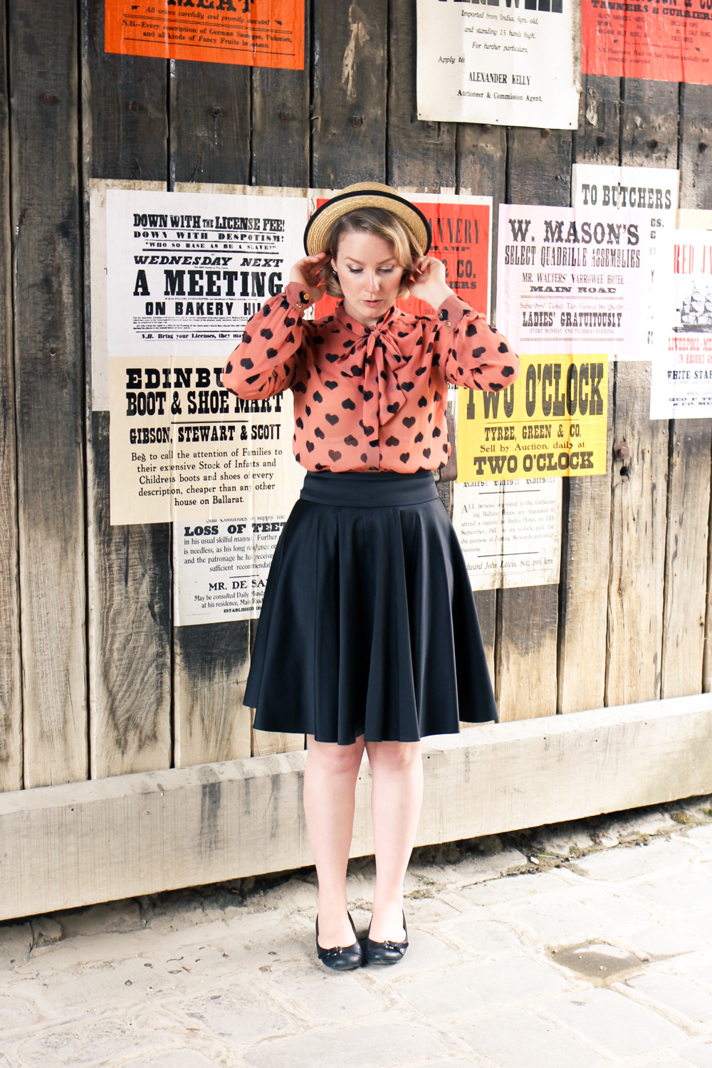 @findingfemme wears Modlcoth pussy bow blouse, with straw boater, black circle skirt and ballet flats at Sovereign Hill.