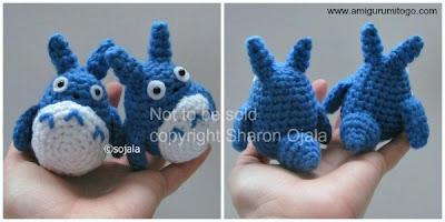 blue crochet totoros inside hand