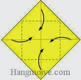 Bước 4: Gấp bốn góc của tờ giấy vào trong.