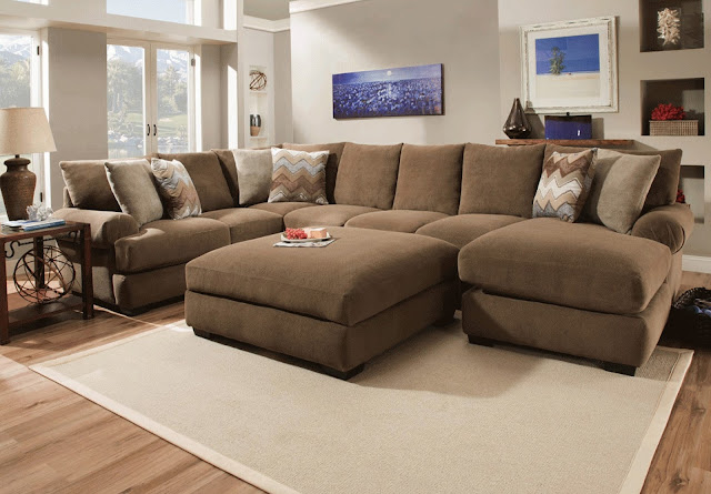 appealing brown overstock sectional sofas with elegant carpet and simple brown pouffe