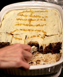 Hand Cutting Slice of Aloha Cake