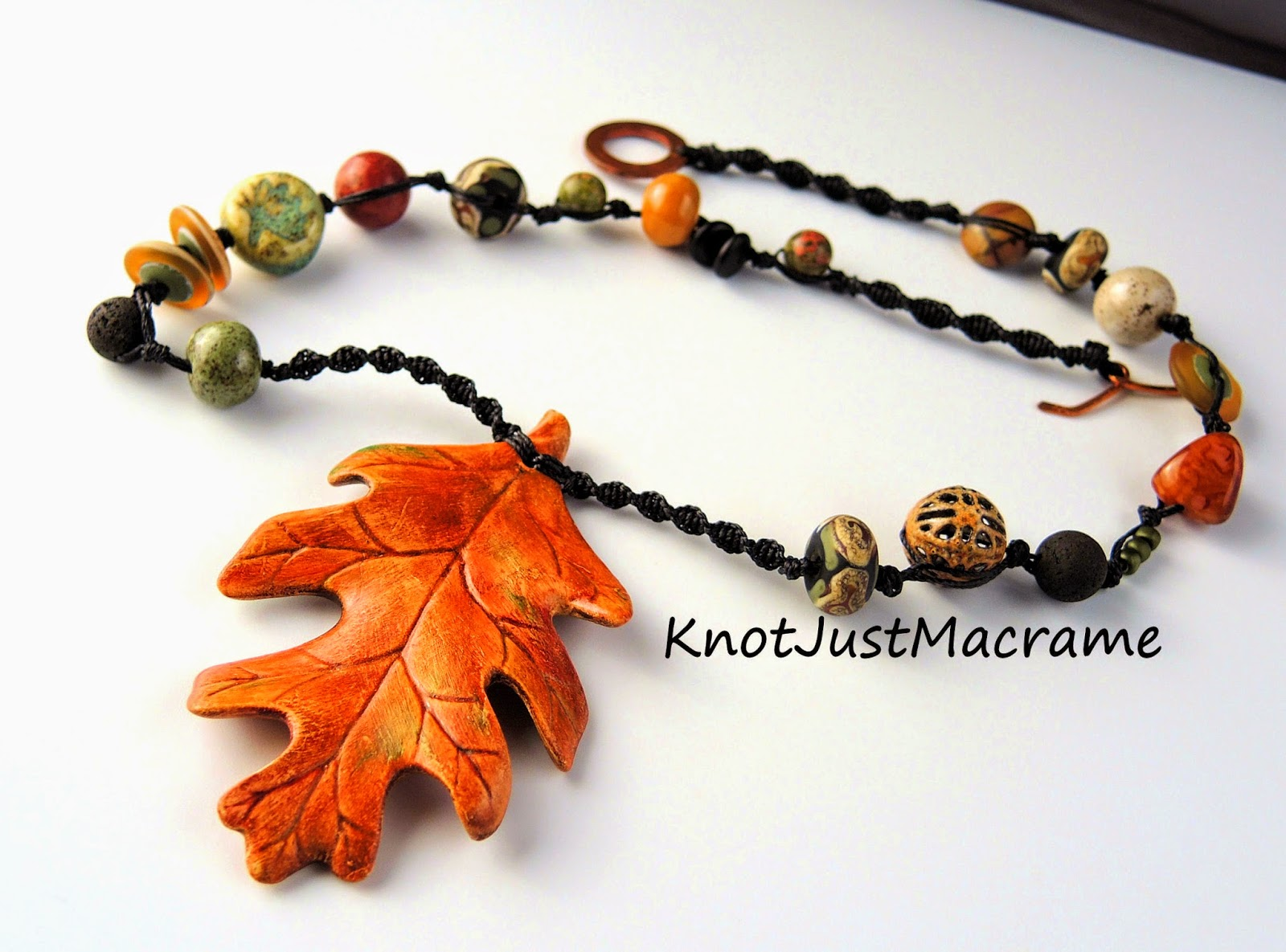 Macrame necklace by Sherri Stokey with ceramic leaf pendant by Marla James.