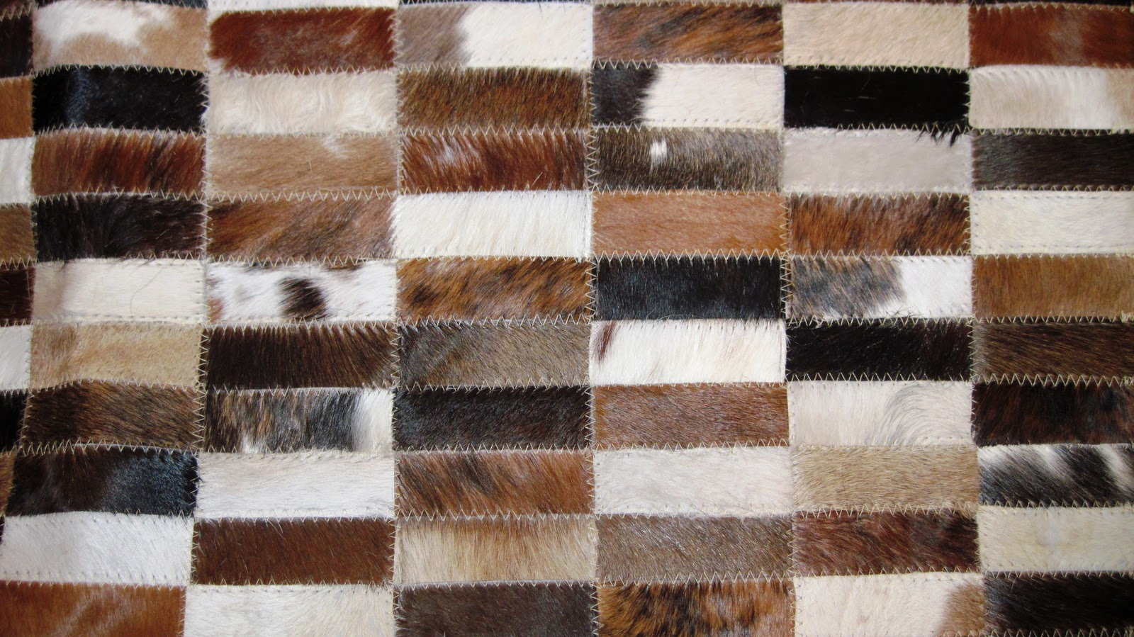 Cowhide rugs beckwith interiors 39 s blog for Cowhide rug houston
