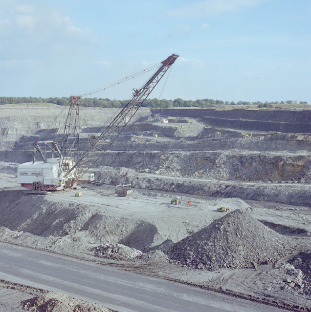 'Big Geordie' dragline. Butterwell Opencast Coal Site, Northumberland. The dragline ('Big Geordie') used to excavate rock from the deepest parts of the excavation. The gently sloping benches from which successively higher coal seams are extracted can be clearly seen in the background.
