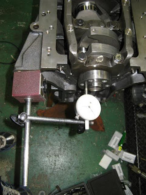 Measure end play in crank seating on engine rebuild