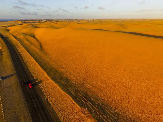 Namibia: Atlantic Coast: sand dunes & ocean aerial photo gallery