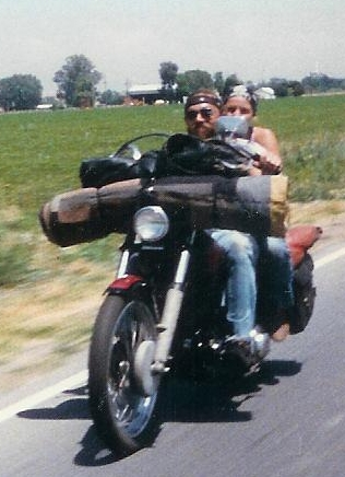 couple on knucklehead chopper with homemade bedroll