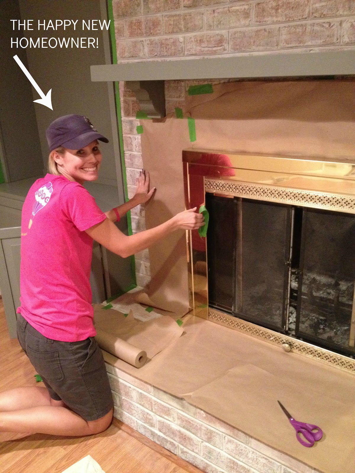 Brass fireplace update east coast creative blog once the edges are take care of youll want to use the craft paper and tape to make sure all of the brick is covered its sorta like wrapping a really big eventshaper