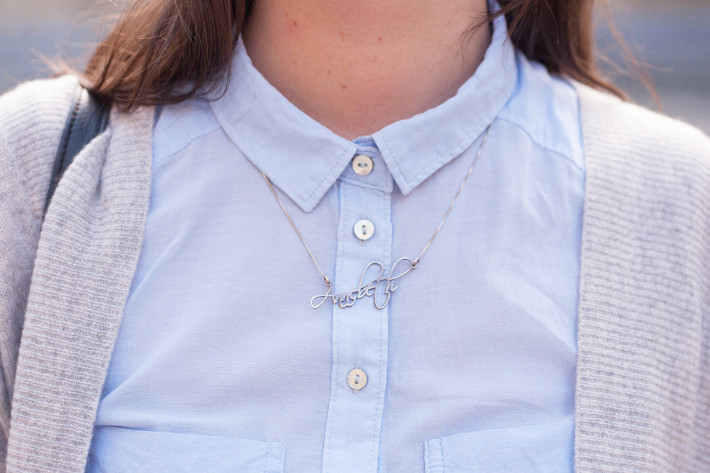 Name necklace over button up