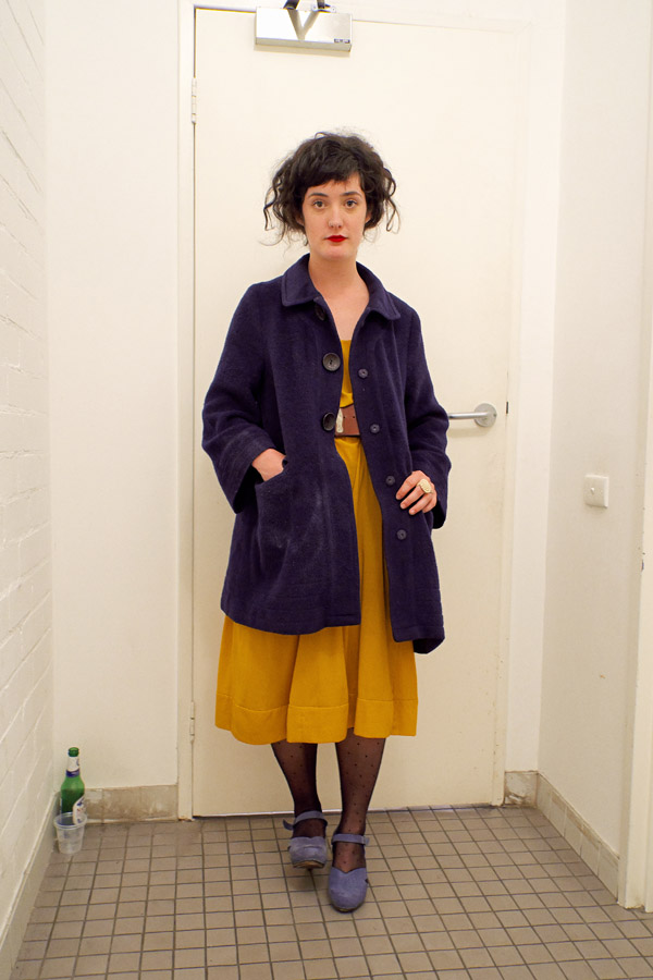 Colour blocked in Vintage style, purple velvet coat over mustard 50s dress, spotted black stockings and  purple dance shoe.
