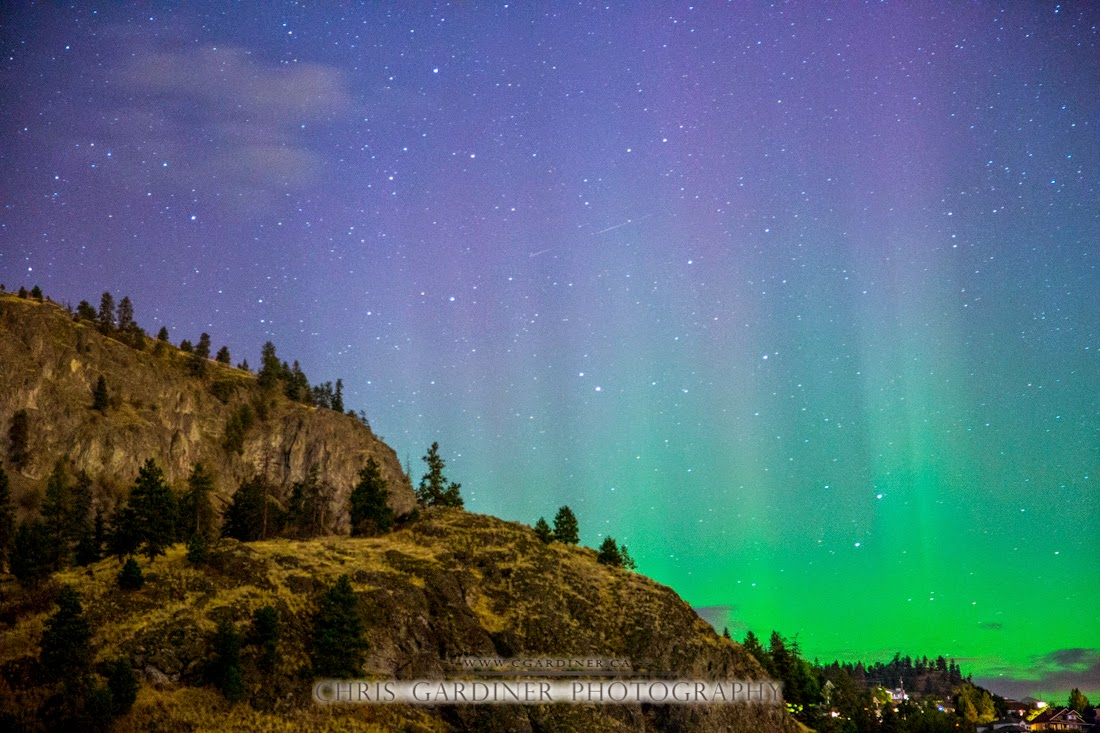 Aurora Borealis Northern Lights Photography by Chris Gardiner www.cgardiner.ca showing green and purple glow of the lights in the night sky outside of Kelowna British Columbia Canada from Bear Creek Campground. Copyrighted 2014 Chris Gardiner