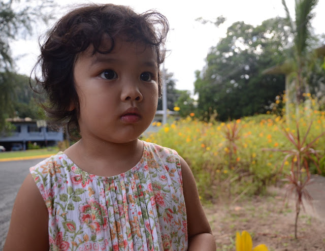 Kecil in front of the flower patch