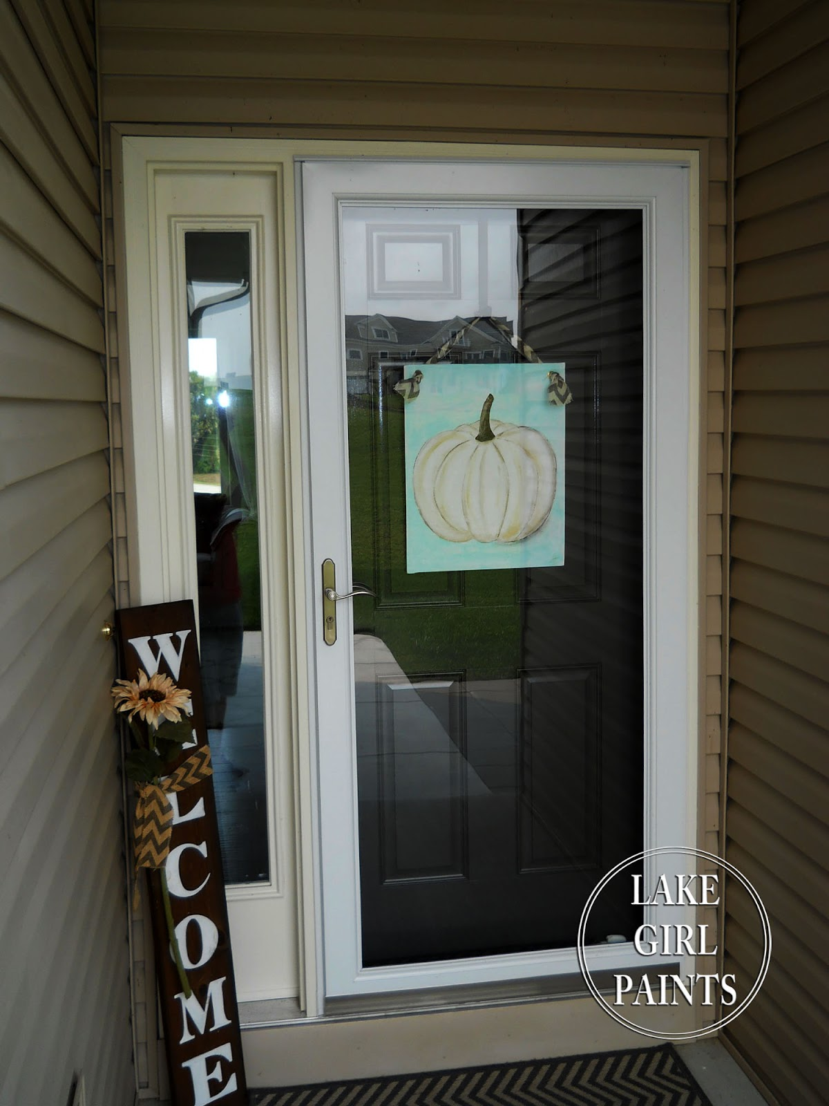 Now you have a fun fall welcome. & Lake Girl Paints: How to Paint a Canvas Pumpkin Door Hanging