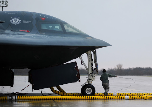 Maintainers and crew chiefs, prepare B-2 Stealth Bombers for Operation Odyssey Dawn
