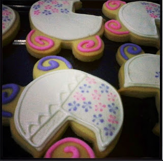 baby stroller pink purple white theme fancy cookies