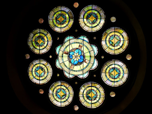 Stained-glass window at the front of the church