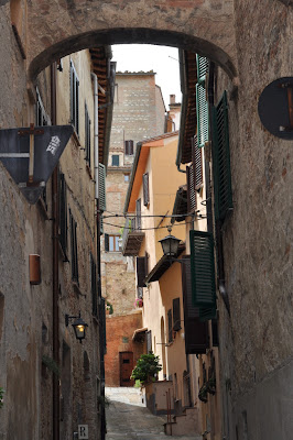 Buildings on a Side Street in Montepulciano, Italy - Photo by Taste As You Go