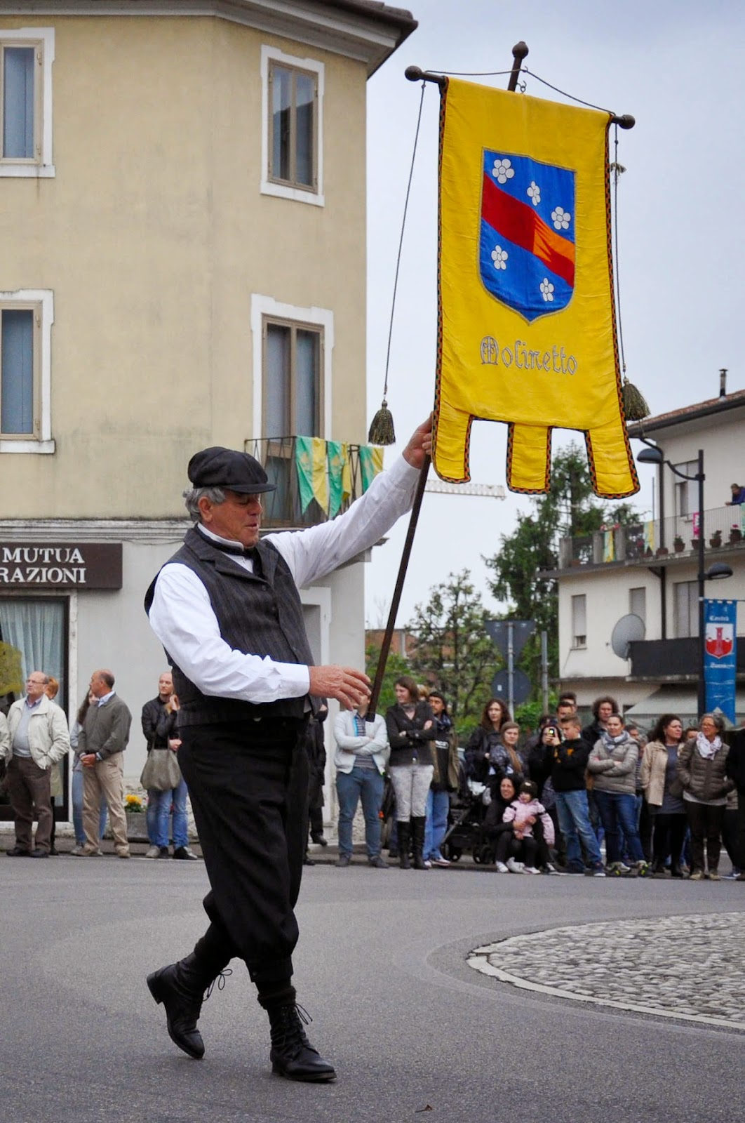 A flag bearer at the Parade, Donkey Race, Romano d'Ezzelino, Veneto, Italy