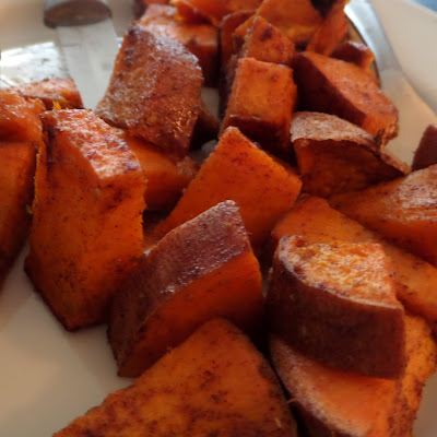 Bite-sized chunks of sweet potato tossed in coconut oil, cumin, and cinnamon.  Then baked until crispy and soft.