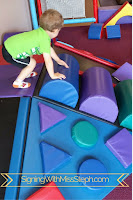 three year old uses toddler sized foam climber with slide