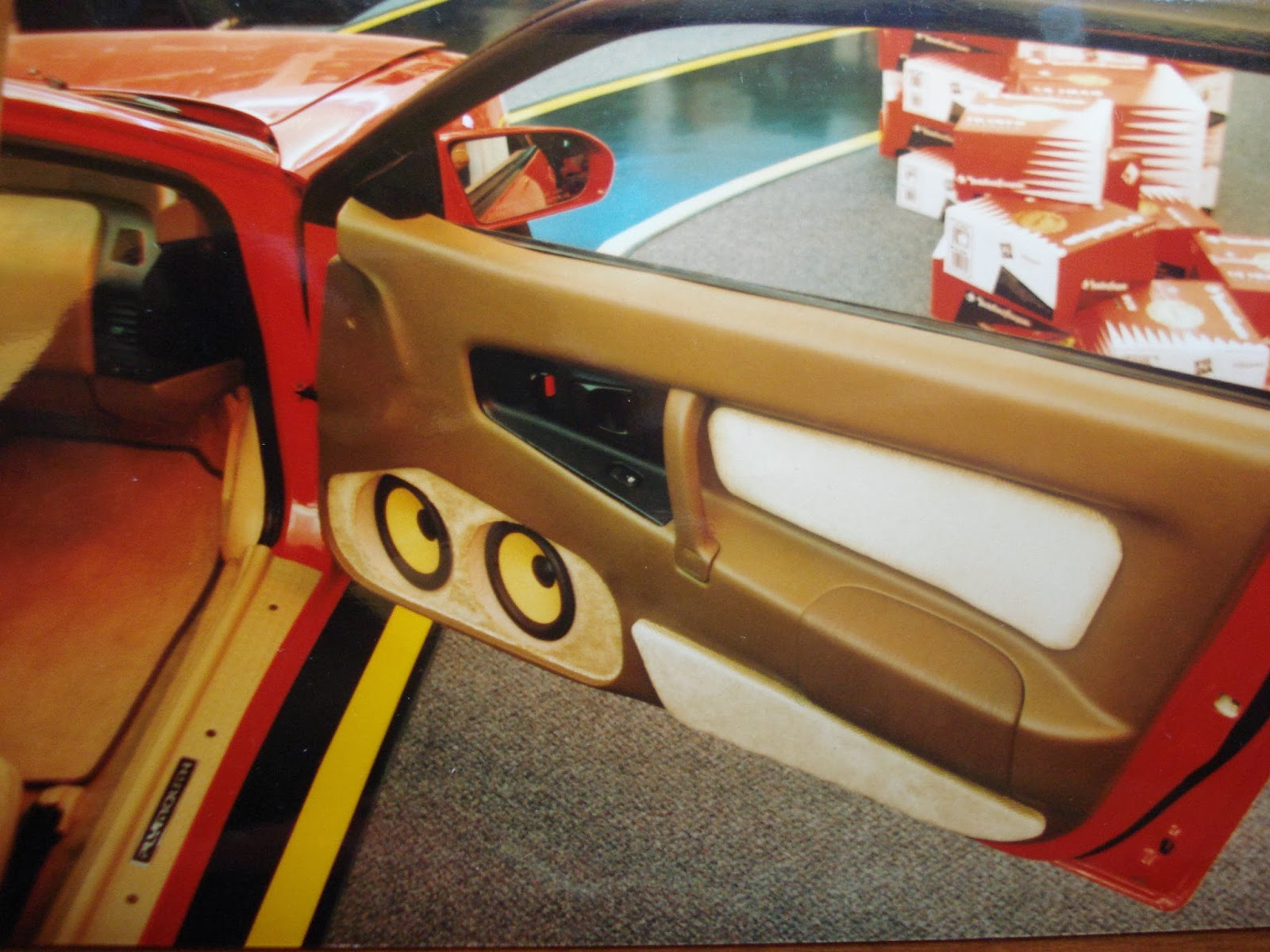 Photo image of the right open door without speaker grills of Chuck Barbosa's Red Laser as it stood during the winter storage at the end of 1995 and beginning of 1996.