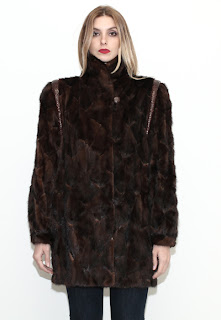 Vintage 1970's brown mink coat with snakeskin details at the shoulders.