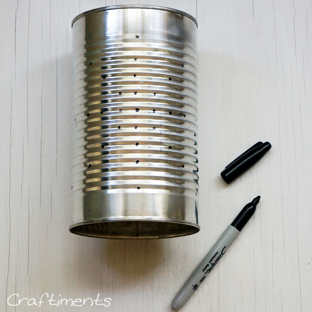 Clean tin can and draw design with permanent marker.