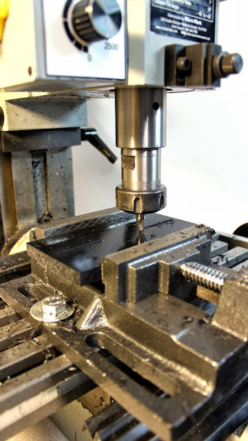 Slots are machined in the middle plate of the camera stabilizer head plate to allow for camera adjustment