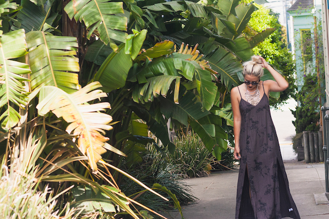 edgy bohemian style by san francisco fashion blogger Bryn Newman of Stone Fox Style. She wears a dark brown floral maxi dress by Element Eden with a bun, light makeup, and a burgundy lip with oversized bohemian accessories by the 2bandits.
