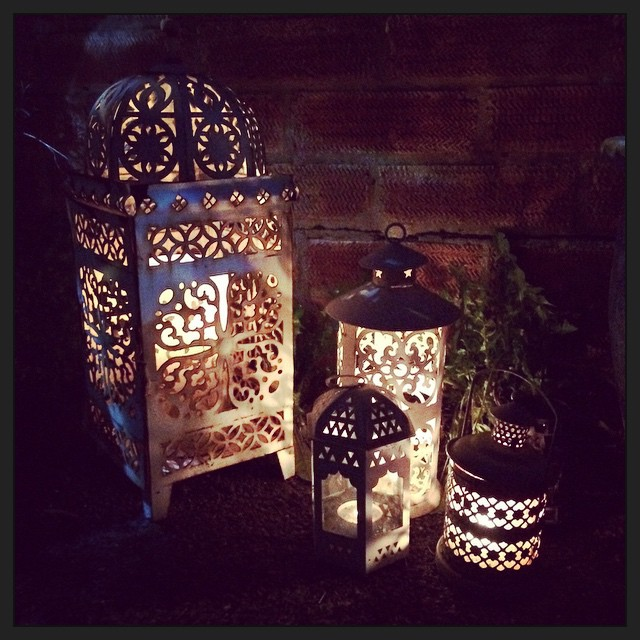 multiple lanterns outside with tea lights