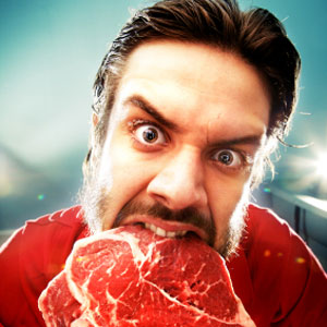 man eats raw meat 